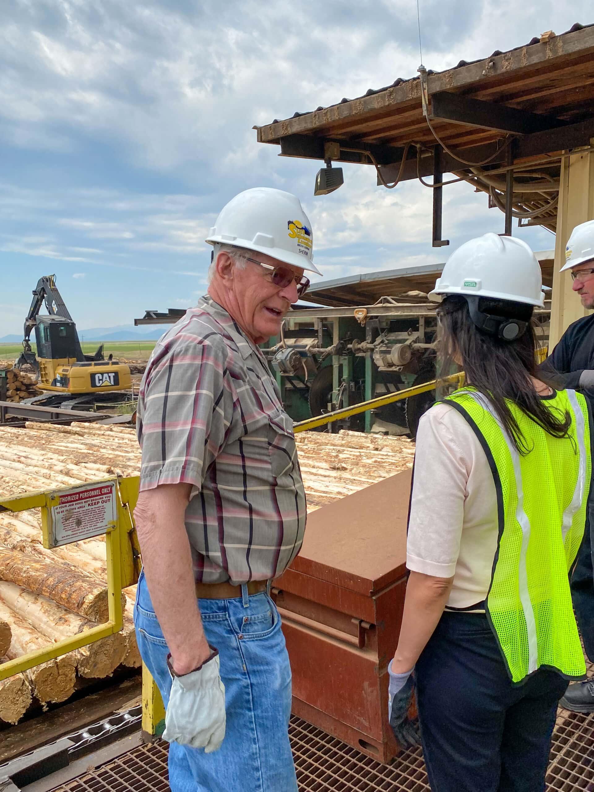 Sun Mountain Lumber, Inc. owner Sherm Anderson talks with Montana Secretary of State Christi Jacobsen